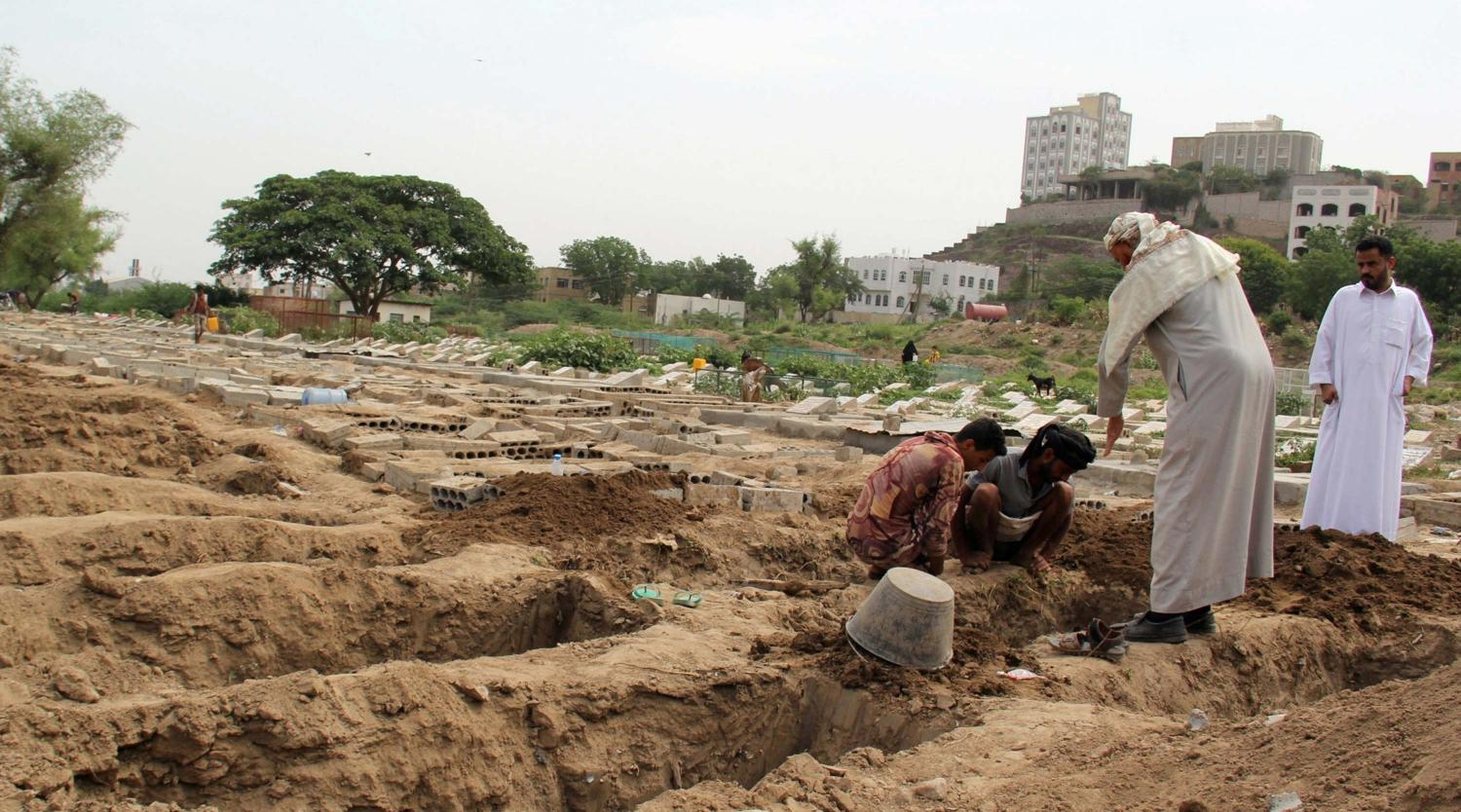 People dig graves at a cemetery where victims of the coronavirus disease (COVID-19) are buried in Taiz, Yemen June 23, 2020. Picture taken June 23, 2020.