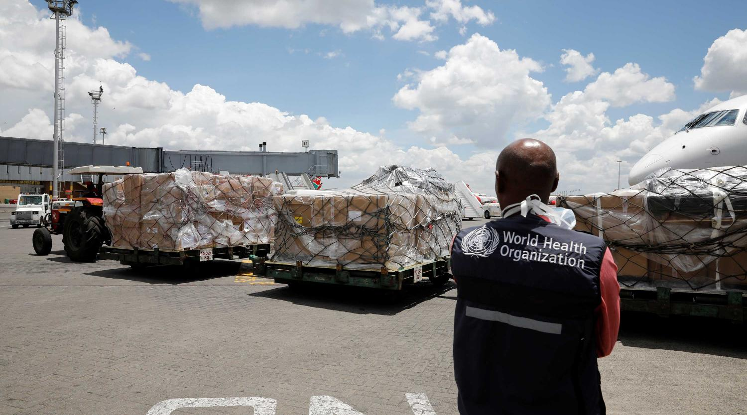 A world health organization (WHO) worker watches as a shipment of medical supplies arrive in Africa to fight the coronavirus disease (COVID-19). Nairobi, Kenya, March 24, 2020. REUTERS/Baz Ratner